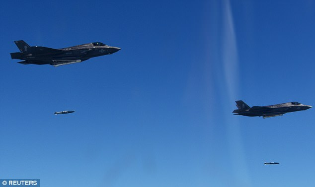 The United States flew some of its most advanced warplanes in bombing drills with ally South Korea on Thursday, a clear warning to North Korea. Above, two U.S. Marine Corps F-35 fighter jets participating in the live-fire drill