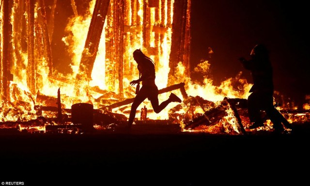 A Burning Man participant evading the attempted tackles of multiple rangers and law enforcement personnel