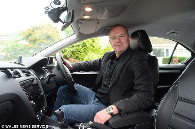 Despite his substantially lower income, Dr O'Keefe is enjoying his new career as an Uber driver