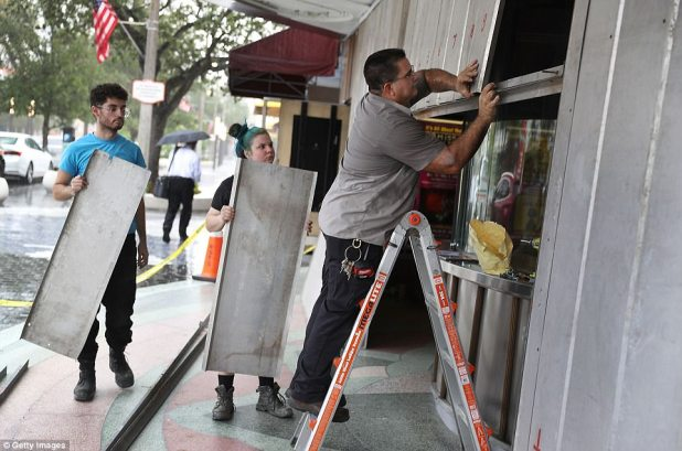 People put up shutters as they prepare the Actors' Playhouse at the Miracle Theatre for Hurricane Irma on Wednesday in Miami, Florida