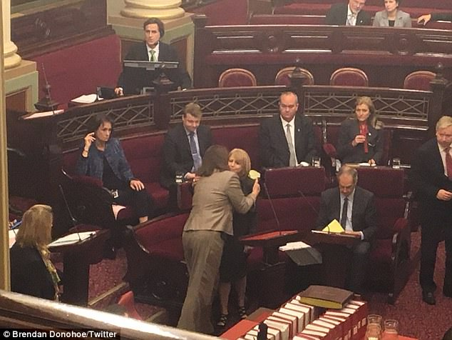 A picture shared on Twitter by a 7News reporter shows other MPs consoling MP Rachel Carling Jenkinsafter the speech