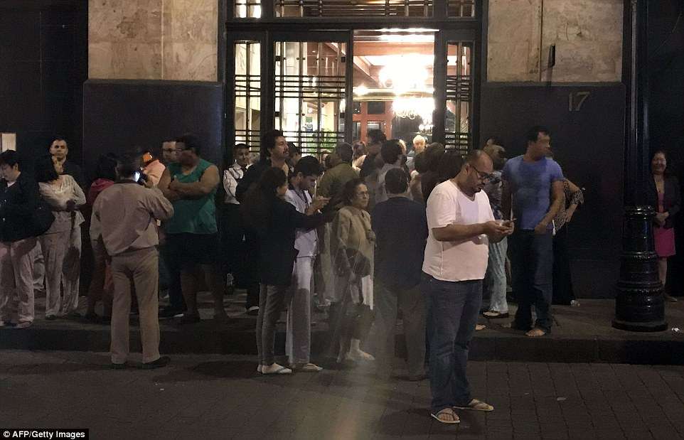 The earthquake was felt across Mexico, shaking buildings in the country's capital amid reports tremors were detected as a far away as Austin, Texas - more than 1,300 miles from the epicentre. This was the scene in downtown Mexico City late last night