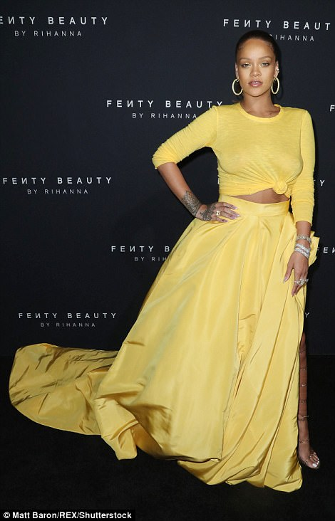 Shine bright like a diamond! Rihanna, 29, looked like a confident designer in a large bright yellow skirt with an oversized train to unveiled her new Fenty beauty line at New York Fashion Week