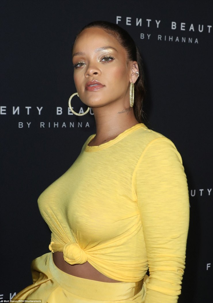 Shine bright like a diamond! Rihanna , 29, ensured she looked her very best as she stormed the red carpet in a sensational yellow coord, in which she rocked a scanty crop top which left very little to the imagination under which she went braless
