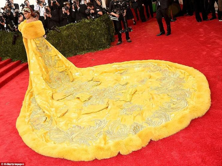 Way back when: The yellow gown had echoes of the famous dress she wore for the 2015 Chinese-themed Met Gala bash in New York, where she quite literally shut down the red carpet in a huge yellow gown - by Chinese couture designer Guo Pei - that left little space for anyone else