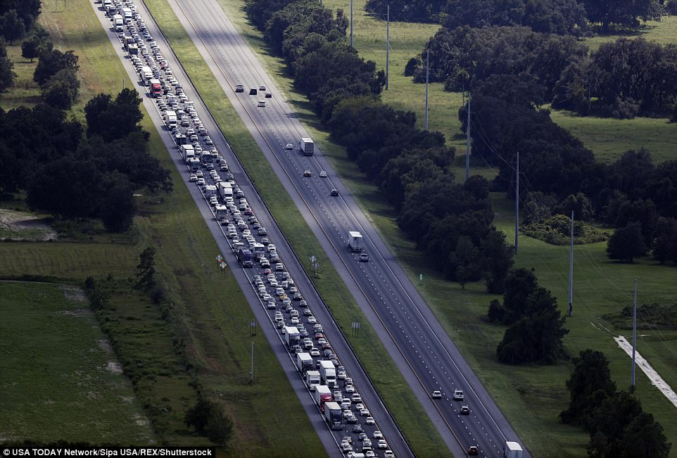 Florida residents flee Hurricane Irma as traffic backs up on I-75 at its intersection with the Florida Turnpike on Thursday