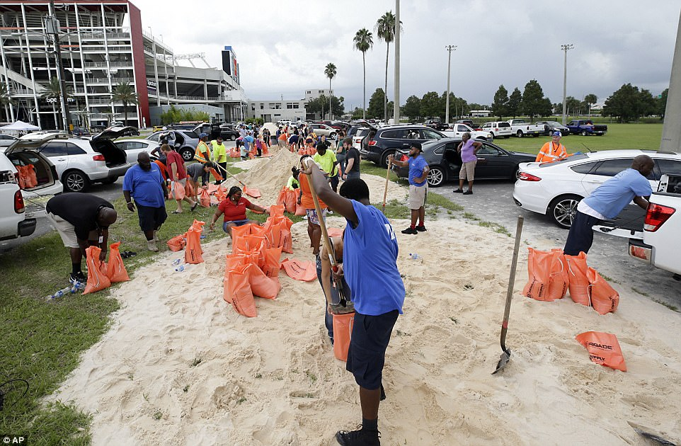 Orlando city employees and volunteers fill sandbags for residents as they prepare for Hurricane Irma on Friday