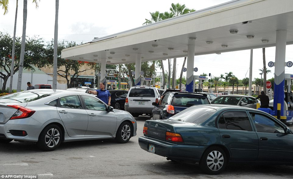 People line up to get gas during preparations for hurricane Irma in Miami, Florida on Friday