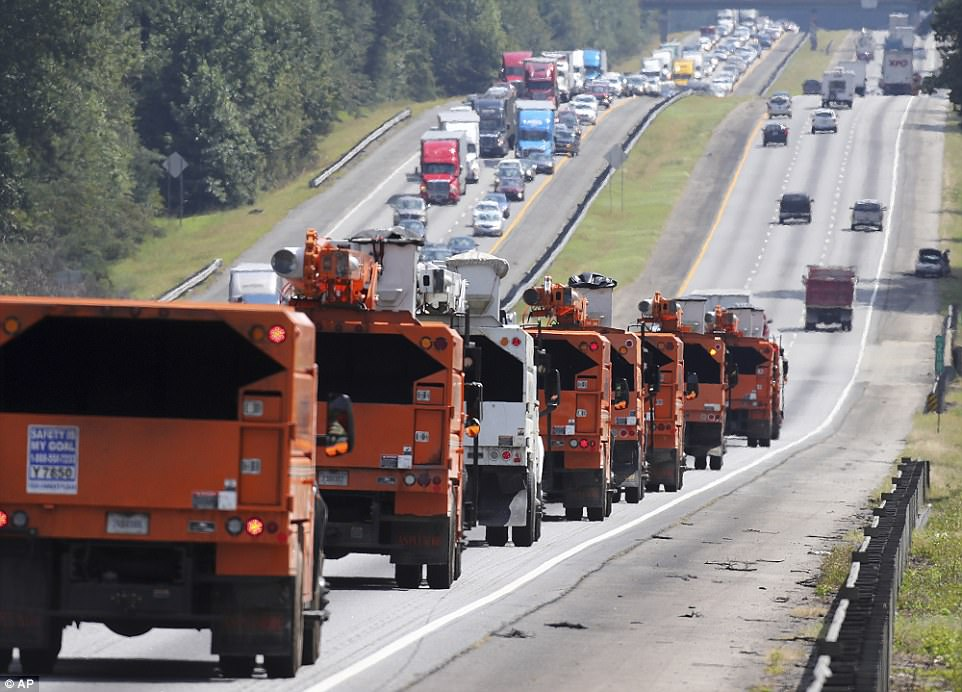 Traffic along Interstate 75 north, rear, crawls toward Atlanta as drivers flee Hurricane Irma on Friday in Griffin, Georgia