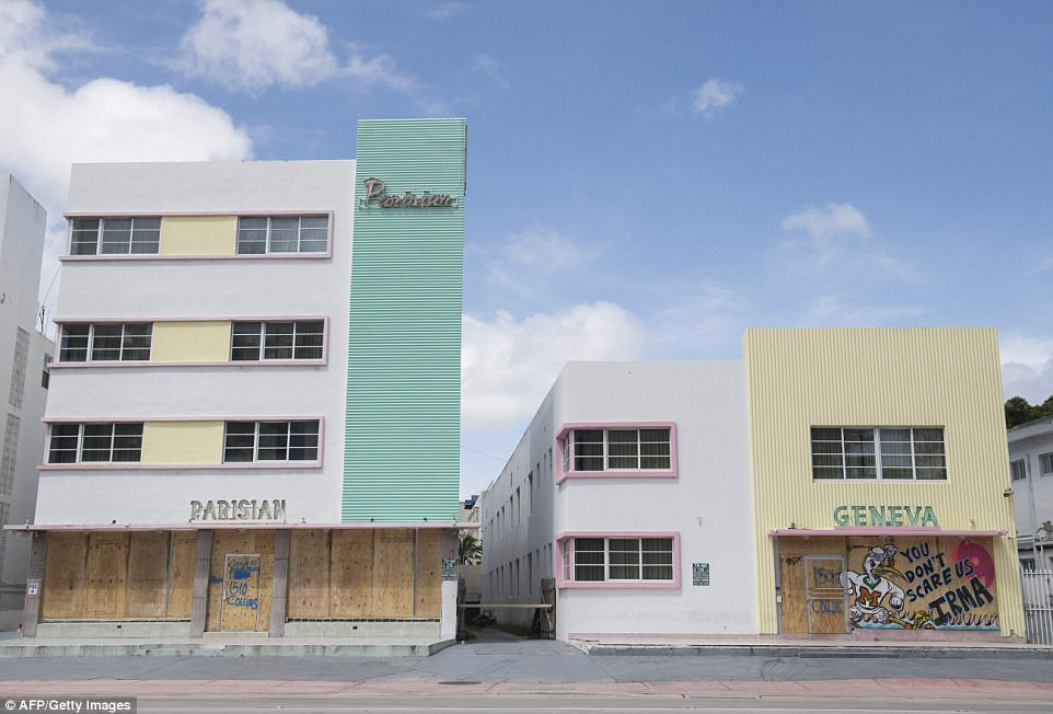 Boarded up buildings are seen in preparation of Hurricane Irma during a mandatory evacuation in Miami Beach, Florida on Friday