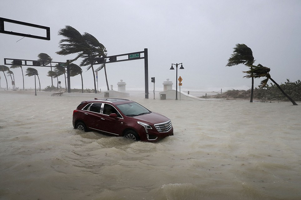 A car sits abandoned in storm surge along North Fort Lauderdale Beach Boulevard. Irma made initial landfall at 9:10am on the Florida Keys, which are now the subject of a massive relief effort. Five people have been confirmed dead in the disaster