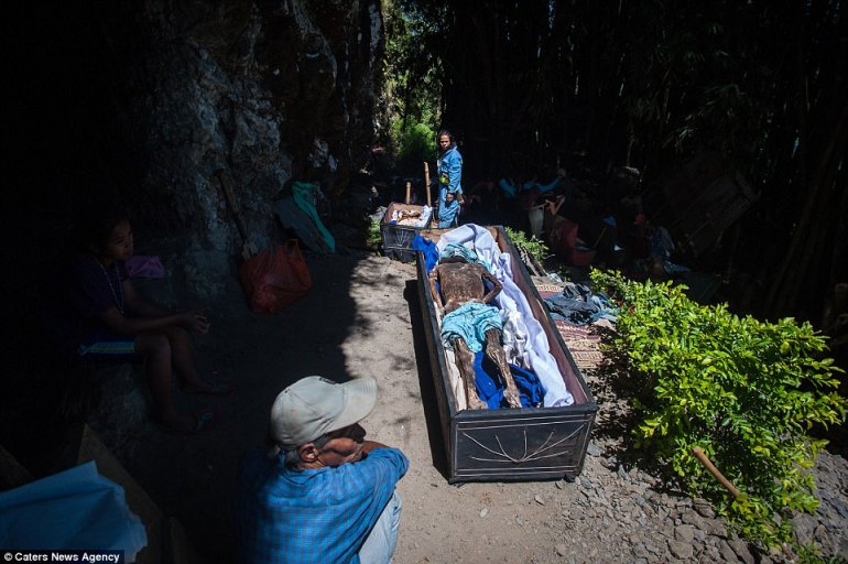 Caves are commonly used by Torjan people as a place to store their dead, as it allows them to access the bodies easily for rituals such as this, as well as communicating with them