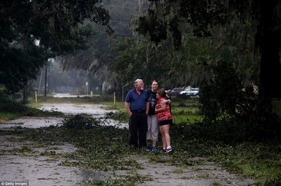 Neighbors emerge from their homes to get a first look at the damage to their neighborhood caused by Hurricane Irma on September 11, 2017 in Fort Meade, Florida