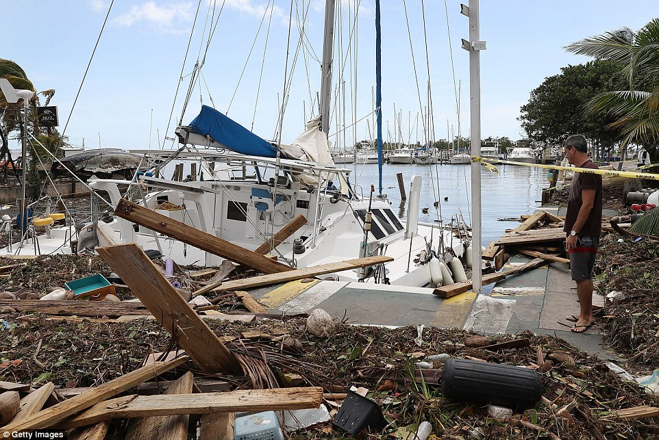 A damaged boat is seen at the Dinner Key marina after Hurricane Irma passed through the area on September 11, 2017 in Miami, Florida