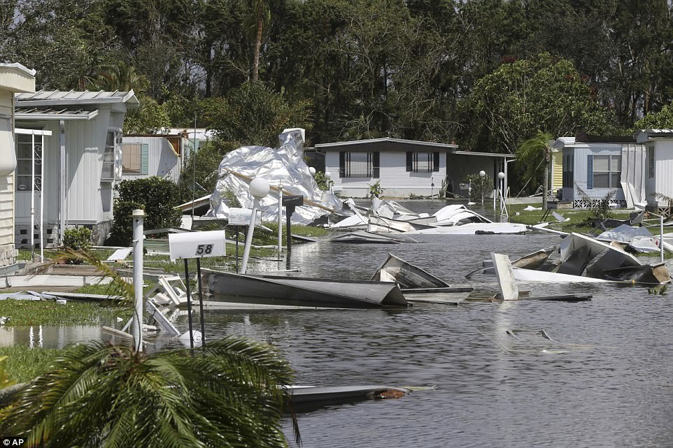 Debris from destroyed mobile sit in the Naples Estates mobile home park in the aftermath of Hurricane Irma in Naples, Florida Monday, September 11, 2017