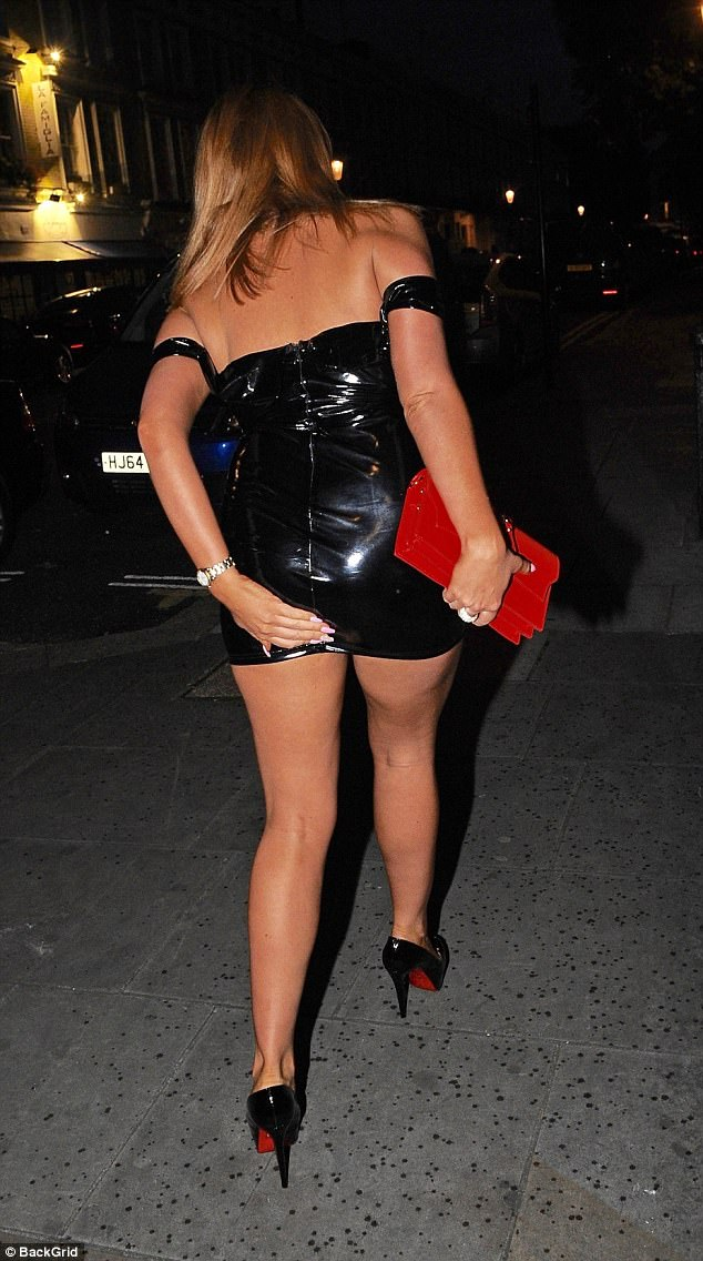 Legs eleven: The stunning star was stumbling down the road in a tiny mini dress