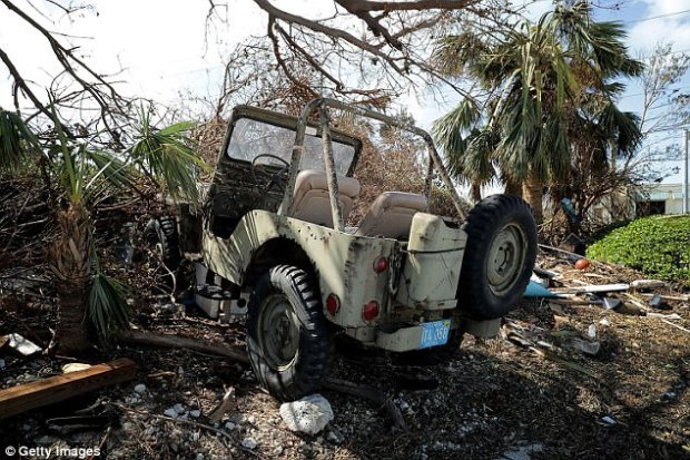 A jeep destroyed by hurricane storm surge water sits in a yard two days after Hurricane Irma slammed into the state on September 12, 2017 in Marathon, Florida. The Federal Emergency Managment Agency has reported that 25-percent of all homes in the Florida Keys were destroyed and 65-percent sustained major damage when they took a direct hit from Hurricane Irma