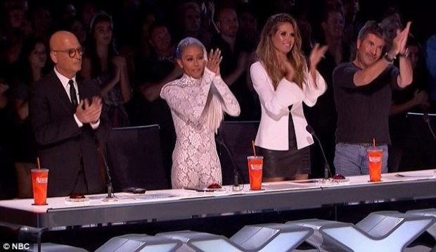 Praise: After Kechi was done singing, Simon Cowell, Heidi, Mel and Howie Mandel all got up from their seats to give her a standing ovation
