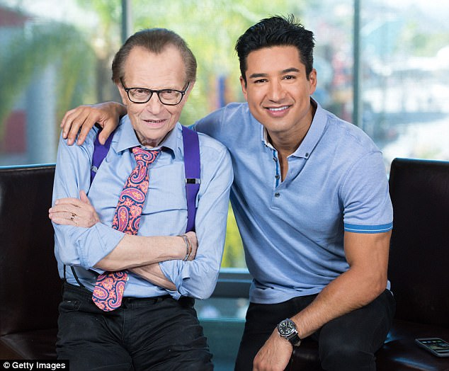 King, who is pictured with Extra's Mario Lopez on Tuesday, revealed his battle with cancer nearly two months after he had the tumor removed