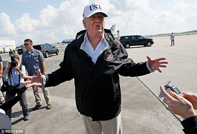 President Donald Trump says he expects funding for his border wall to pass when he's ready for it or Republicans will become the obstructionists in Congress. He talked to reporters from the tarmac in Florida