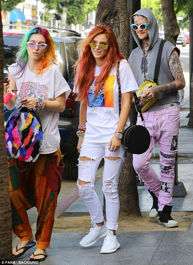 Colourful trio:Her sexy appearance comes after she was spotted on a shopping trip on Hollywood Boulevard on Thursday with sister Dani and rumoured new squeeze, Lil Peep