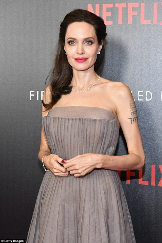Elegant:Angelina obviously turned heads thanks to her grey backless gown