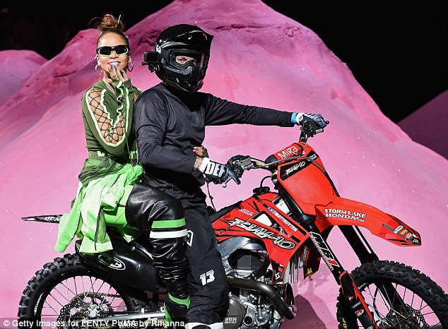 The star of the show: Rihanna herself even did a lap of the catwalk - riding on the back of a motorbike that was being driven by an unnamed man