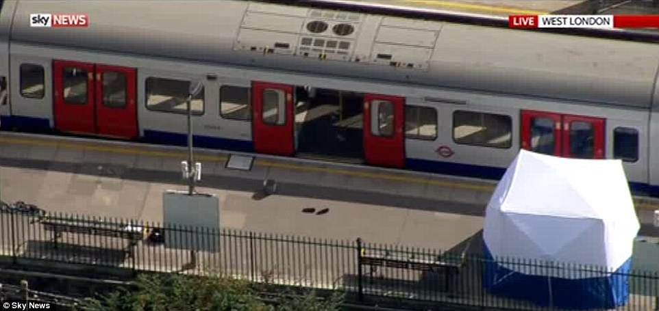 A forensics tent has been erected on the platform - although there have been no fatalities - and a single pair of shoes lies abandoned outside the door where the bomb ignited