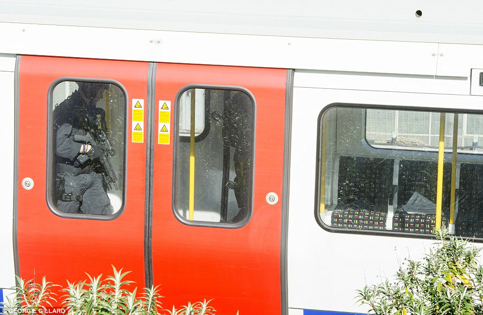 Armed police boarded the train in the incident as the hunt for the bomber was stepped up