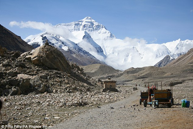The official height of Mount Everest -- which lies in the Himalayan range, straddling the border between Nepal and China -- is 8,848 metres (29,029 feet), first recorded by an Indian survey in 1954