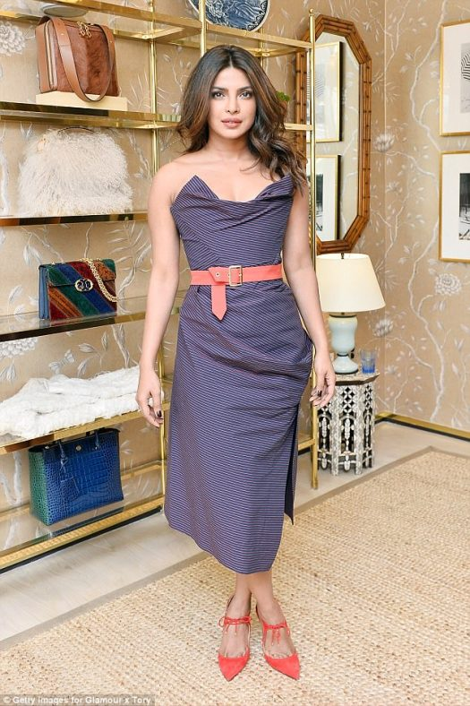 Pinstripe Fridays: Priyanka Chopra stunned in a strapless dress at the Glamour x Tory Burch Women To Watch Lunch on Friday in Beverly Hills, California