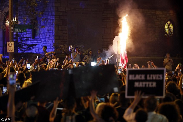 Moments earlier, demonstrators were also seen burning American flags as they were marching through the mayor's neighborhood