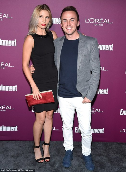 Middle:Frankie Muniz - star of Malcom In The Middle - cut a dapper figure with his girlfriend