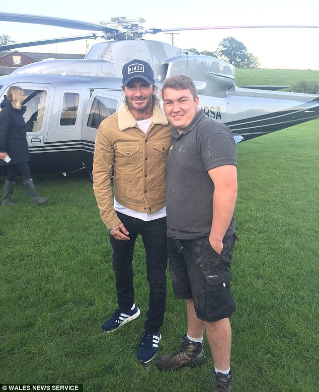 Flying high: Meanwhile, his dad David Beckham, left, gave locals in a Welsh village in Powys a thrill when he touched down in a helicopter on the field at Llanrhaeadr FC