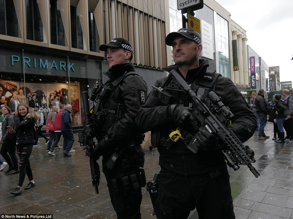 Armed police officers patrol Northumberland Street in Newcastle today following the UK's threat level being raised to critical following yesterday's attack in London