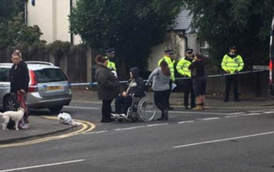 Cordons are being put in place at a 100 yard radius as police carry out a search of the address in Sunbury-on-Thames