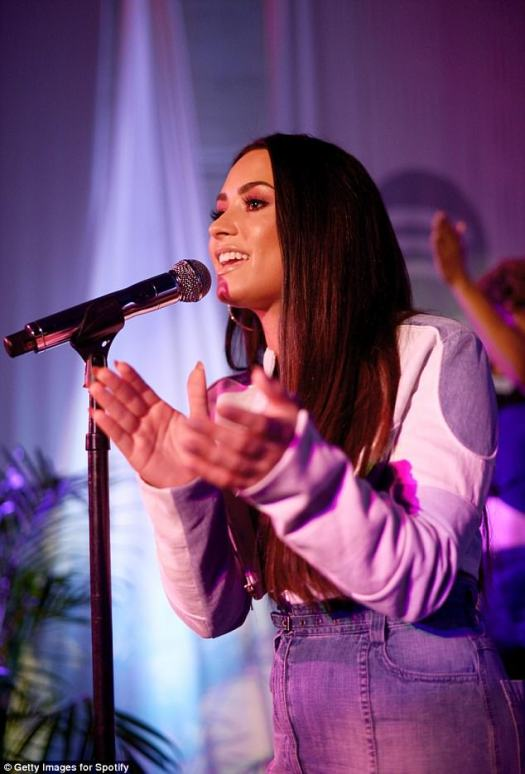 Flashing flesh: The 25-year-old singer put on a busty display in a skimpy bra top, as she belted out her latest hits, at RVCC in Los Angeles