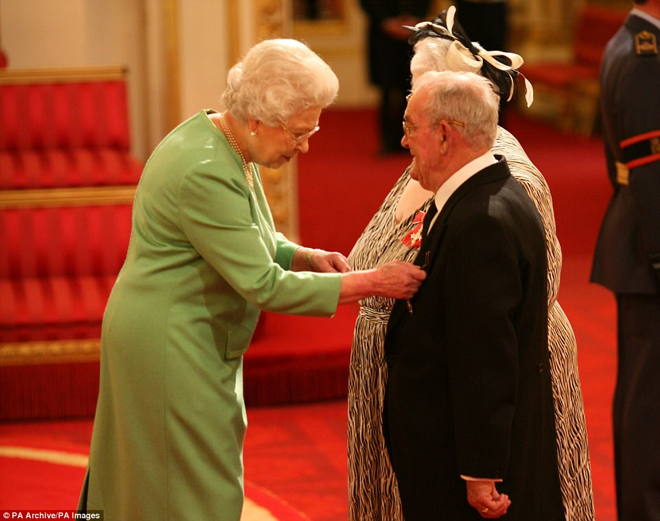 Ronald and Penelope Jones receive MBEs from the Queen in 2009 for fostering hundreds of children. The couple own the house in Sunbury-on-Thames that has been raided although it is not known if they or any of their foster children still live there