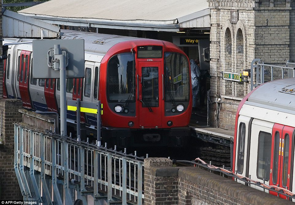 The abandoned train at Parsons Green on Friday morning after a terrorist left a bucket bomb on the carriage floor