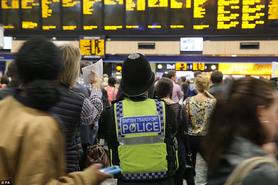 Security was stepped up at stations around London following yeterday morning's attack. Pictured is a British Transport Police officers at Euston