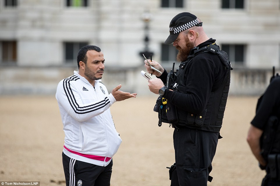 Aman has documentation checked as security is increased on Horse Guards Parade