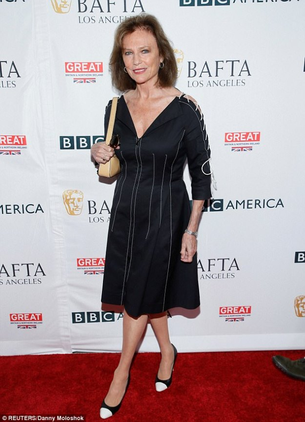 Turned 73 on Wednesday! The Golden Globe winner dressed her evergreen 5ft6in figure in a black dress featuring corseted midi-sleeves and white piping with white-toed pumps