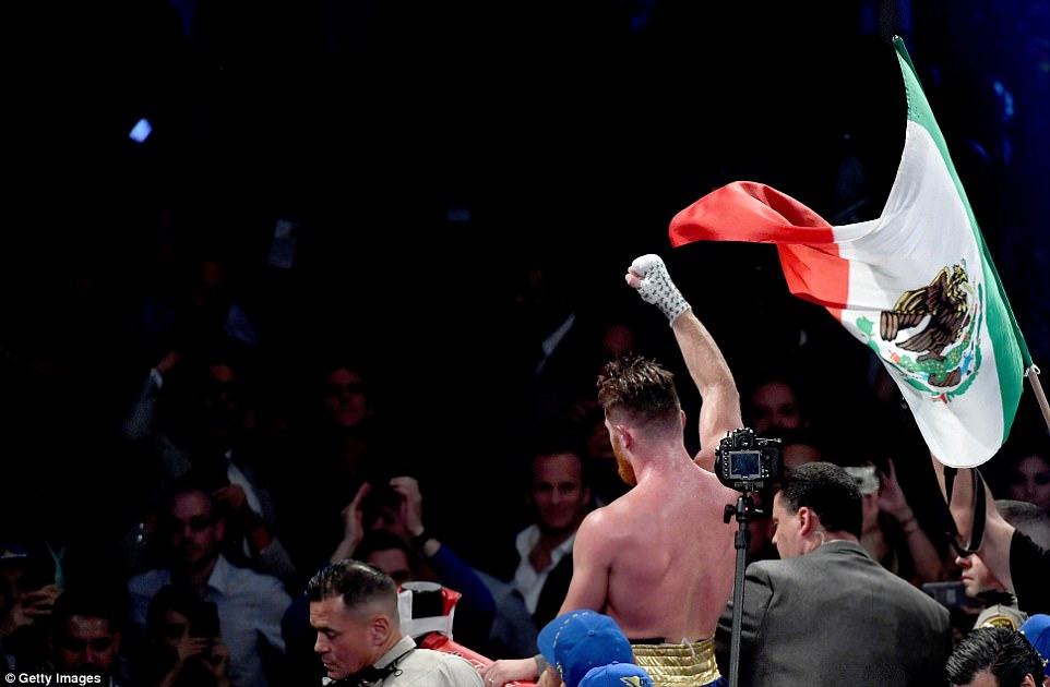 Alvarez, backed by a large contingent of Mexican fans, held his national flag aloft before the result of the fight was announced