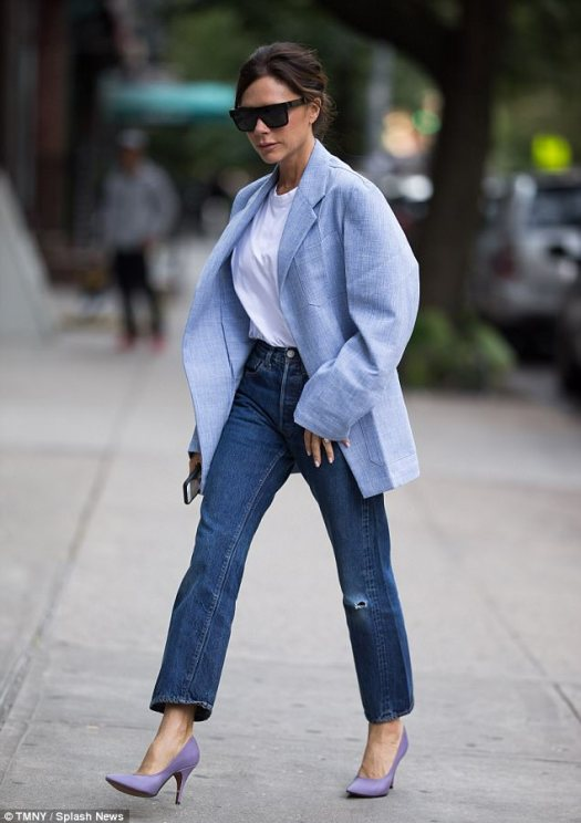 Stylish: The icon slipped a pair of angular dark shades over her eyes, and swept her brunette tresses back into a chic up do
