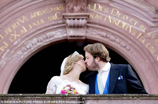 Blushing bride:Viktoria Luise wore a dazzling off-the shoulder lace gown with a full skirt and a diamond-studded antique tiara