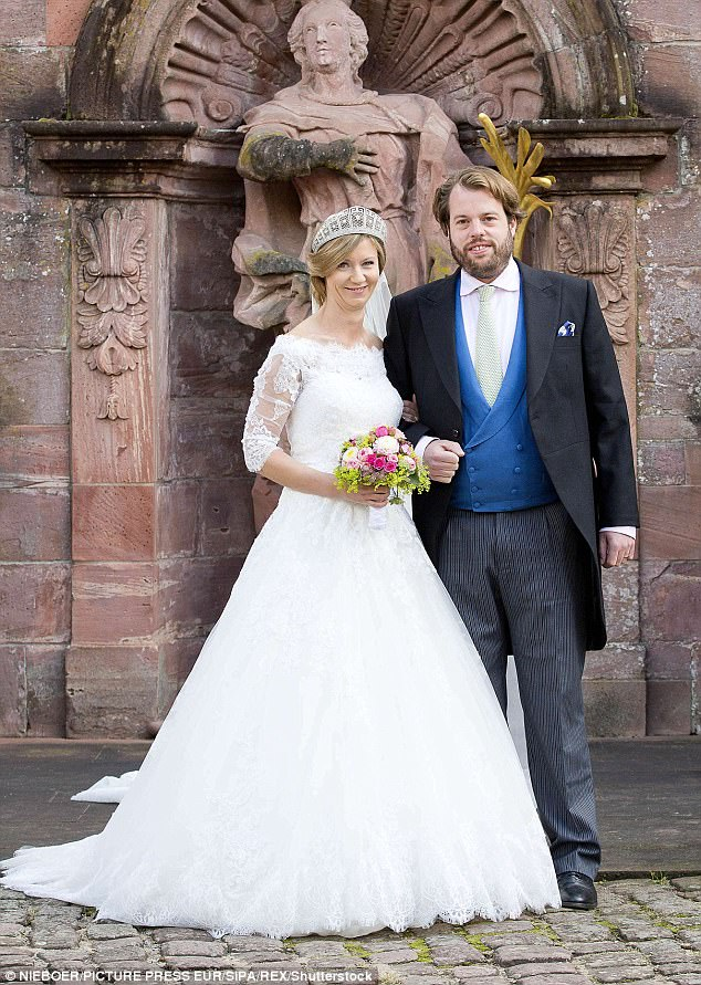 Main event:The couple,  both 35, had their civil reception in April but the full pomp and pageantry was reserved for this weekend's religious ceremony in Amorbach, Germany