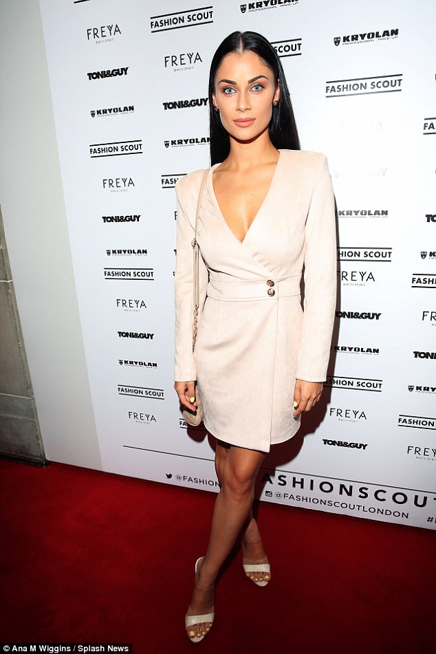 Demure: Cally-Jane Beech looked every bit the yummy mummy at the Fashion Scout show in Freemasons' Hall in London on Saturday