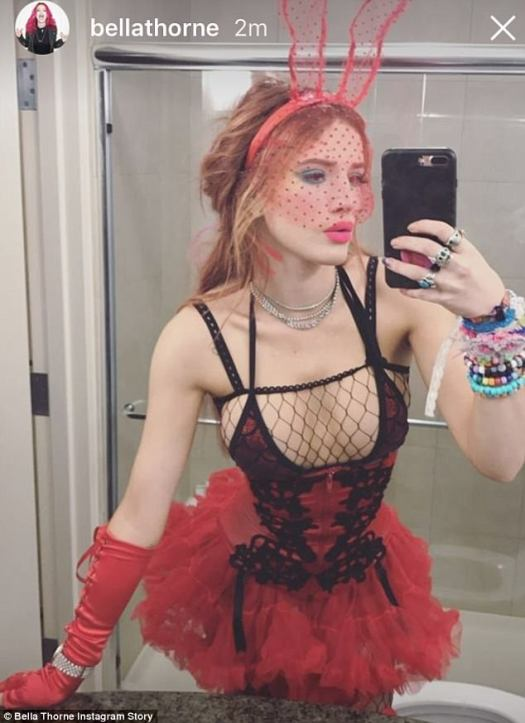 Raunchy: Bella Thorne, 19, channelled her inner Playboy bunny as she flashed her busty assets in a fishnet bralet and racy tut-inspired dress for a night out on Saturday