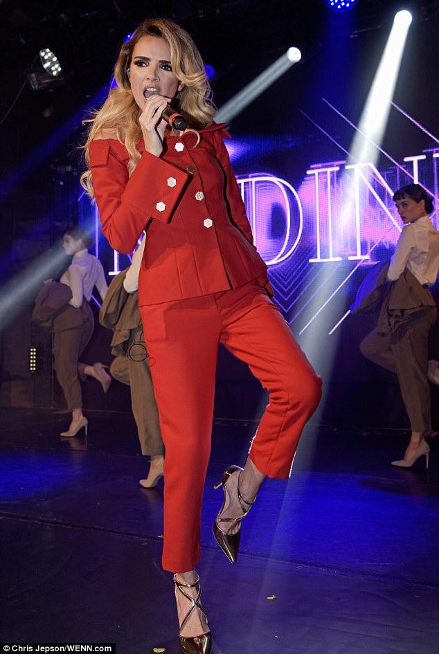 Off to work: The Irish pop star's flowing blonde locks tumbled around her shoulders