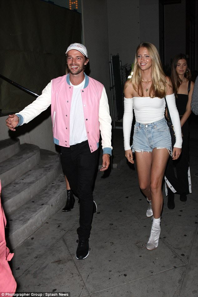 Date night: Patrick Schwarzenegger, 23, took his leggy model girlfriend Abby Champion, 20, out on a date night to Catch restaurant in Los Angeles on Saturday